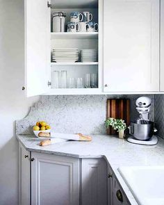 It's All in the Detail - To increase her countertop space without adding any actual square footage to the kitchen, Kristin created an L-shaped countertop. She chose the Martha Stewart Living Quartz countertop in Snowcap to continue the lighter feel of her kitchen.