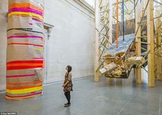 Everyday items: Paper has been wrapped around a pillar with different colour stripes in this installation. Barlow normally uses materials such as builders planks, sheets of plywood, plastic sheeting and plaster in her work