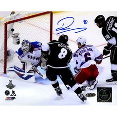 Drew Doughty Signed Los Angeles Kings 2014 Stanley Cup Scoring Goal 8x10 Photo - Kings Star Drew Doughty has personally hand-signed this 8x10 2014 Stanley Cup Scoring Goal Photo-Coming off recently winning the 2014 Stanley Cup Finals against the New York Rangers this young defencemen has no doubt been a huge component in the Kings success. Making his NHL debut at that young age of 18 he was named to the All-Rookie Team. He is also a two time Stanley Cup Champion which is a dream for any…