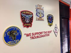 Custom routed signs displaying different military units on post at Ft Campbell