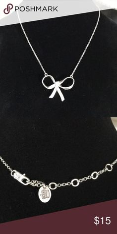 Juicy Couture Bow necklace Juicy Couture bow necklace silver in tone never worn Juicy Couture Jewelry Necklaces