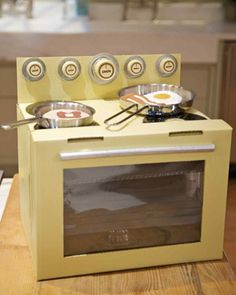 What a fantastic #recycling craft using cardboard, jar lids and other items from home. Cardboard Box Oven Craft. We love this amazing reuse idea from @marthastewart