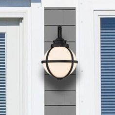 Add a coastal feel to your home with 1 Light Outdoor Sconce. The frosted opal glass globe provides a striking contrast for the textured black finish cage. This fixture will blend well with many styles Outdoor Sconce Lighting, Garage Lighting, Outdoor Light Fixtures, Outdoor Wall Lantern, Porch Lighting, Exterior Lighting, Wall Sconce Lighting, Outdoor Walls, Kitchen Lighting