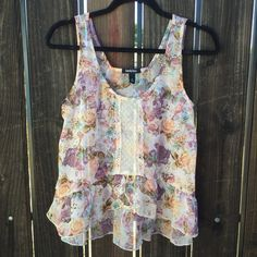 Floral Chiffon High Low Tank Blouse Beautiful lace detailing the front. Flowy and girly. 100% polyester. Tops