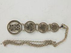 Kette Russland, um 1915, gefertigt aus 4 Silbermünzen, 3 Kopekenmünen mit ausgeschnitten Zarenadler, als Abschluss 1 Rubel mit dem Portrait von Zar Nikolaus II, schöne Fertigung, leichte Tragespuren. L: 39 cm