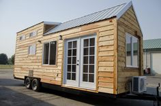 I'm excited to show you this spacious tiny house on wheels by Tiny Idahomes. Tiny Idahomes LLC is a tiny house builder in Nampa, Idaho. They build custom tiny homes for their clients and so far hav. Tiny House Loft, Tiny House Swoon, Micro House, Tiny House Plans, Tiny House On Wheels, Tiny House Design, Tiny House Exterior, Tiny House Builders, Tiny House Listings