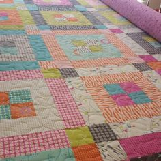 A beautiful bright quilt by Eva G! This one is made using our Strippen Around pattern and a jelly roll #jellyroll #showmethemoda #modajellyroll