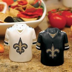 """New Orleans Saints Gameday Ceramic Salt & Pepper Shakers by Football Fanatics. $15.95. Team colors and logo. Hand-painted. Approximately 3 1/2"""" x 3"""". Imported. Ceramic salt and pepper shakers. These fun Gameday jersey salt and pepper shakers are perfect for tailgating or watching the big game at home. The ceramic jersey backs are clearly listed as salt or pepper, so there won't be any game day personal fouls!Ceramic salt and pepper shakersTeam colors and logoHand-pain..."""