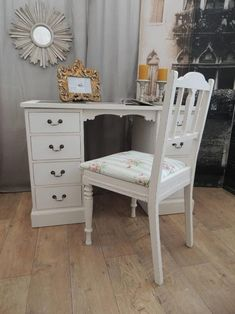 set of white antique desk and chair, shabby chic style, photo in ornate golden frame, candles and round decorative mirror