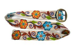 White with Beautiful hand stitched floral pattern. Elegant and fun, perfect for Spring! Made by Peruvian Accent.