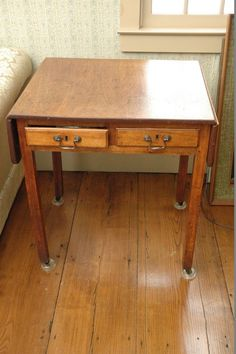 """Antique simple wood drop leaf table. Extraordinary. Original hardware and measuring 25"""" x 22"""" x 30"""", with drop leaf down."""