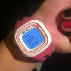 Runner wearing her Garmin fitness sports watch on the inside of her wrist