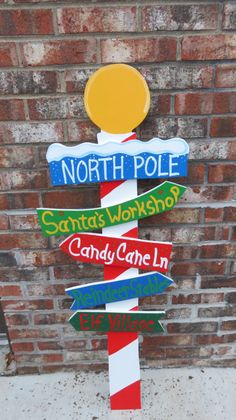 Christmas North Pole Sign with Direction Signs by ChartinisYardArt