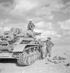 A wrecked Panzer IV is checked out by New Zealand troops near Tobruk, Libya December 1941.