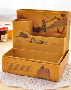 Keepsake box displaying illustrations from Le Petit Prince (The Little Prince). Great for the home office or to store jewelry. Foldable.