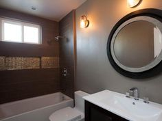 Anicka and Shauna chose a neutral brown color palette that complements the adjacent master bedroom, and added a touch of functional glam with a sparkling tiled shower niche.