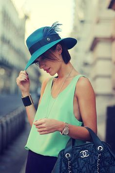 mint tank and feather hat!
