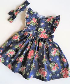 Gorgeous navy and wild rose pinafore is perfect for summer or winter. Just add a long sleeved top. Cute Toddler Girl Clothes, Fall Baby Clothes, Toddler Outfits, Kids Outfits, Cute Girl Dresses, Little Dresses, Pretty Dresses, Dress Anak, Kurta Neck Design