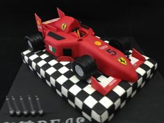 This boy loves speed! Ferrari chocolate cake on checkered chocolate base.