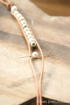 im gonna do this with pearls and navy blue cord for dallas cowboys bracelet...