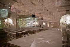 Kehoe Designs — Events - Wedding Fire & Ice - Brilliance is reflected by thousands of cut glass gems sparkling like diamonds, quietly riveting the attention of wedding guests touched with soft light in the pattern of flames.