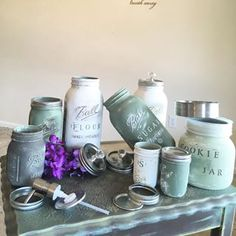 Handmade re-cycled and up-cycled farmhouse kitchen decor made out of Mason jars in small and large sizes then containers were painted in dark green and distressed with quality chalk paint colors light green, brown  and finally personalized with printed letters and words in white for a beautiful shabby chic style kitchen set: flour, sugar, coffee, cookie container and soap dispenser.