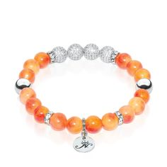 Carnelian Eternity Crystal Bracelet. Semiprecious orange Carnelian Stone with white zircon crystal and .925 sterling silver. Hand-crafted from 8mm natural stone and sterling silver beads. Each bridal bracelet is highlighted by a row of sterling silver beads studded with stunning zircon crystal, and is accented with a branded silver tag set between two crystal encrusted charms. See more at: http://www.josephnogucci.com/collections/infinity-crystal/products/carnelian-crystal