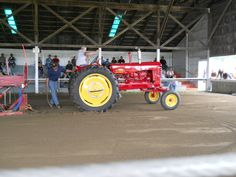 Tractor Pulling Contest with a Massey Harris #33 Tractor.     https://www.youtube.com/user/Viewwithme