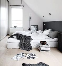 A truly good bedroom can pull off an unmade bed. | 21 Cosy Bedrooms That Will Make You Want To Sleep In