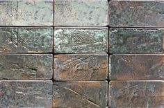 Handmade industrial style tile, rectangular with a metalic glaze