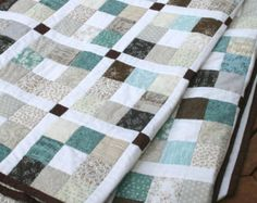 This is a 9 page instant download PDF quilt pattern. You will be able to download the PDF file as soon as your payment has cleared. The pattern uses a jelly roll (or 2 for larger sizes) plus some solid fabric.  It is an easy beginner quilt pattern and includes step by step instructions and plenty of photos to guide you through all the stages of quilt making - rotary cutting, piecing, making the quilt sandwich, machine quilting and binding your quilt. It is quick ansd satisfying to construct…