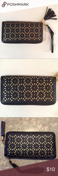 Wristlet With Removable Strap Wristlet has removable strap, comes in a beautiful black, with gold accent flower designs. Wristlet has full size pocket inside holds credit cards, change and other personal items. Wristlet has zip closure with tassel. Boutique Bags Clutches & Wristlets