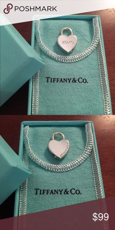 Tiffany & Co 925 Silver XOXO Lock ❤️ Charm Pendant 100% Authentic.  I have 27 Tiffany charms on my bracelet!  Too many!  But of course I still like to add new ones. I'm leaning more toward the enamel ones these days. So I'm selling off a few to make room. Comes with its Tiffany pouch and original box.  No trades.  Can also be used as a pendant.  This is a retired piece now. No longer available from Tiffany. Tiffany & Co. Jewelry