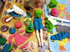 50 fun things to use with playdough including garlic presses, golf tees, wooden letter blocks and rubbing plates.