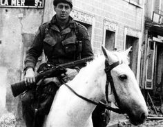 A trooper in the 505th PIR (of the 82nd Airborne) riding the horse he found down Cape Wool Street in Sainte-Mère-Église.