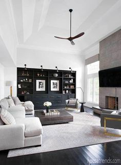 Bright and beautiful remodel - Bright and beautiful remodel A large black built-in and a fireplace that stretches to the ceiling are some of the highlights in this great room. Living Room Grey, Home And Living, Modern Living Room Decor, Condo Living Room, Transitional Living Rooms, Small Living, Living Room Designs, Living Spaces, Bookshelves Built In