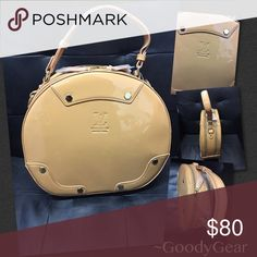 Louis Vuitton Tan Tambourine Purse Louis Vuitton Tambourine Purse Color: Tan This authentic patten leather bag has two zipper compartments both with secret pockets. This bag also comes with a long strap for versatility. Tambourine, Leather Bag, Suitcase, Totes, Louis Vuitton, Pockets, Zipper, Purses, Best Deals