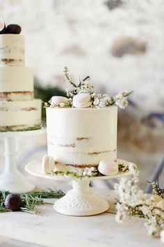 elegant white wedding cake with petite macarons