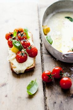 cherry tomatoes on melted mozzarella and toast.