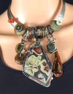 ~Sterling Silver, Oregon Lily Pad Jasper, Dalmation Jasper, Fossil Walrus Ivory (found by the Eskimo's during the summers when it washes up onto their shores), Petrified Wood, Ancient Ammonites, Royal Imperial Jasper,  Ancient Coral, Mohawkite, Ancient Bronze Celtic Rings, Antique Bronze African Rings~