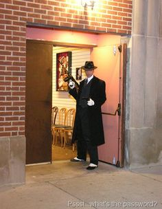 Tommy Gun's Garage: A Roaring 20s Speakeasy. Having guests come in a back entrance adds to the charm of a speakeasy party. Don't forget the password & doorman.