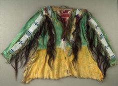 Scalp Shirt c. 1875 - A scalp shirt was worn by the bravest of fighting men. Thus, the making of such a shirt, trimmed with hair from enemy scalps, was both a holy and solemn occasion. Only a warrior who himself possessed a scalp shirt could make one for another warrior.