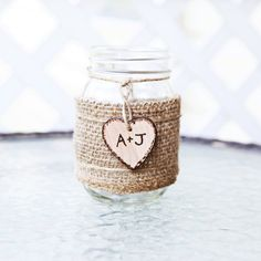 Personalized Rustic Mason Jar Vase with brown burlap wrap and custom wood heart. Also great for Christmas or holiday gift gifts, baby shower prize prizes, bridal shower favors, wedding party, flower bouquet holder, diy centerpiece, favor, table number sign, and more!