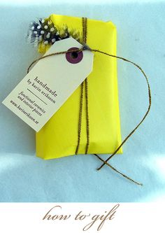 yellow, feather, and twine wrapping