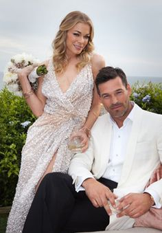 Eddie Cibrian and LeAnn Rimes were married on April 22, 2011.    The intimate wedding took place at a private estate in Malibu amongst 35 guests.    Rimes wore a custom pearl and paillette encrusted wedding dress by Reem Acra with an art deco brooch by Neil Lane pinned at the waist. She carried a bouquet of cream colored peonies.