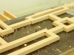 With the template pinned on top, I can now router the waste wood away and be left with an identical model - only thicker. The wood under - is the actual mirror frame, or part of it..!