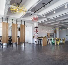 the concept for the multi-studio office focuses around a three segment plan that encompasses various public, semi-public, and private areas spread from the center.