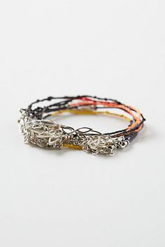 """Flores Wrap Bracelet #anthropologie This one is $148! Knotted cord and leaf chain would make a great """"knockoff"""" piece"""