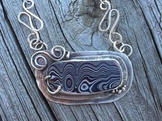 """Fordite Artisan Pendant in Sterling Silver. Unique one if a kind """"Detroit Agate"""" """"Motor City Agate"""" handcrafted necklace by LoMoStudio on Etsy"""