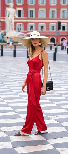 d5cefe7eb3e6 Red satin jumpsuit and wide brim hat in Nice
